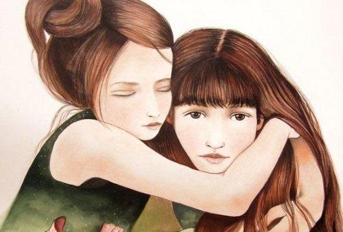 una-hermana-abrazando-a-la-otra-500x338